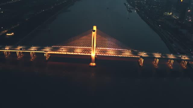 aerial night view of zhuhai hengqin bridge - macao flag stock videos & royalty-free footage