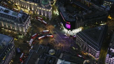 aerial night view piccadilly circus evening traffic london - london england bildbanksvideor och videomaterial från bakom kulisserna