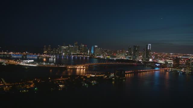 aerial night view port miami skyline florida usa - macarthur causeway bridge stock videos & royalty-free footage