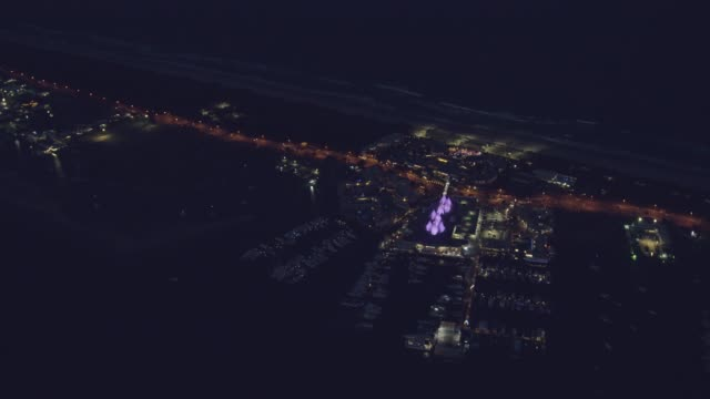 aerial night view sea world gold coast queensland - jachthafen stock-videos und b-roll-filmmaterial