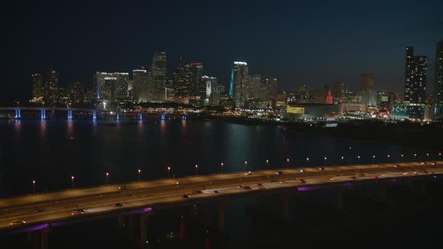 aerial night view venetian way downtown miami florida - macarthur causeway bridge stock videos & royalty-free footage
