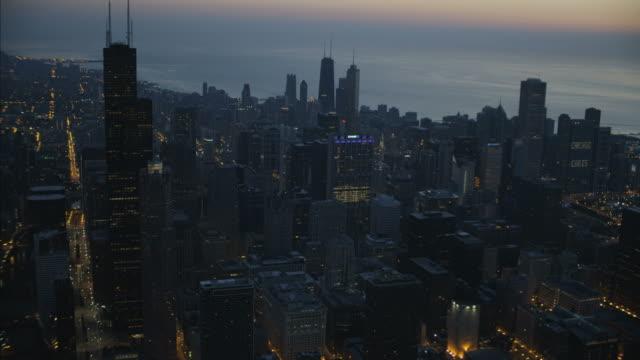 aerial night view willis tower millennium park chicago - millennium park chicago bildbanksvideor och videomaterial från bakom kulisserna