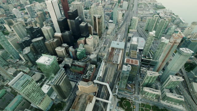 aerial nightfall timelapse of urban city center toronto from above. wide shot, day to night - spoonfilm stock-videos und b-roll-filmmaterial