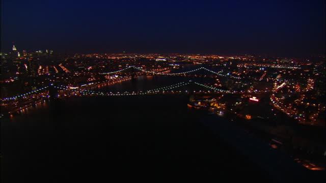 Aerial nighttime over Manhattan and Brooklyn Bridges/ New York, New York