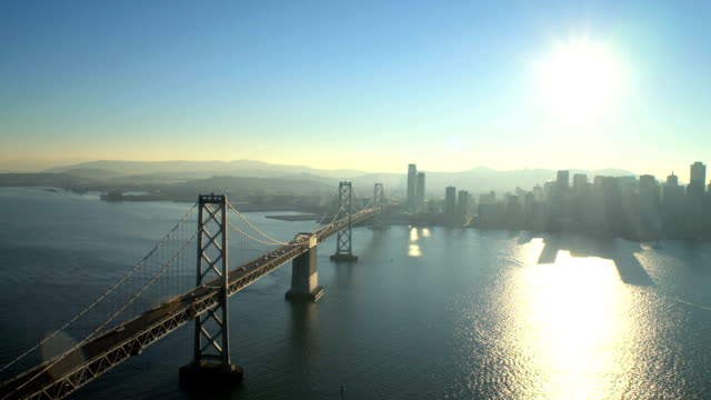 aerial oakland bay suspension bridge skyscrapers san francisco - california street san francisco stock videos & royalty-free footage