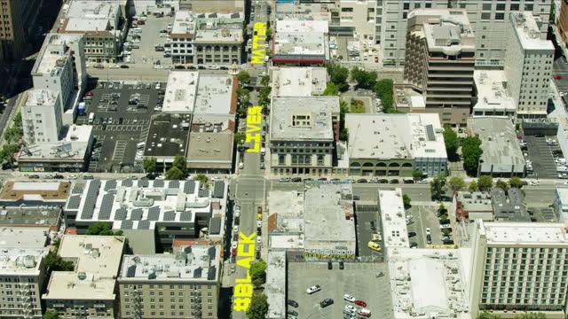 aerial oakland city street painted blm slogan america - san francisco bay area stock videos & royalty-free footage