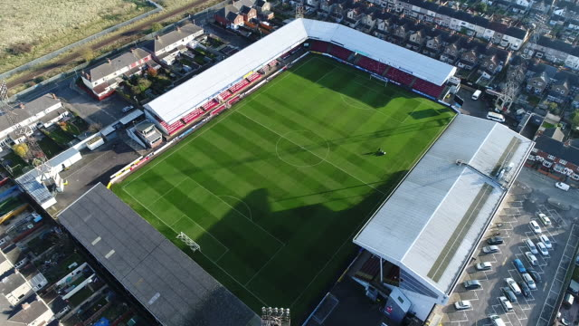 aerial oblique angle view of grimsby town fc's blundell park ground - football pitch stock videos & royalty-free footage