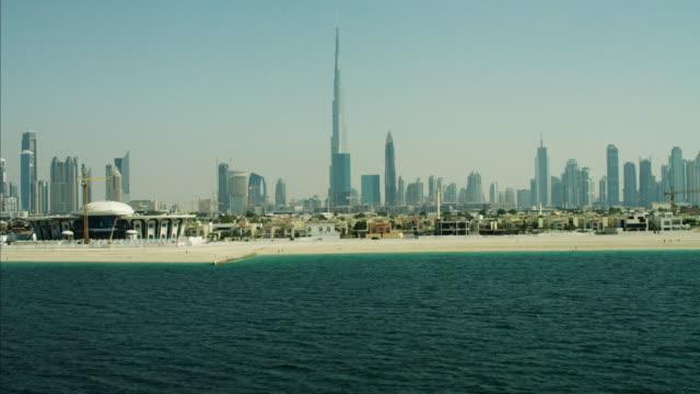 aerial ocean dubai city skyline burj khalifa skyscraper - dubai stock-videos und b-roll-filmmaterial