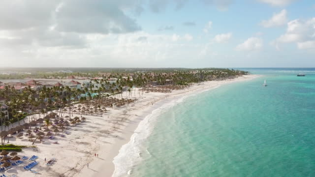 aerial: ocean to beach in punta cana - dominican republic stock videos and b-roll footage