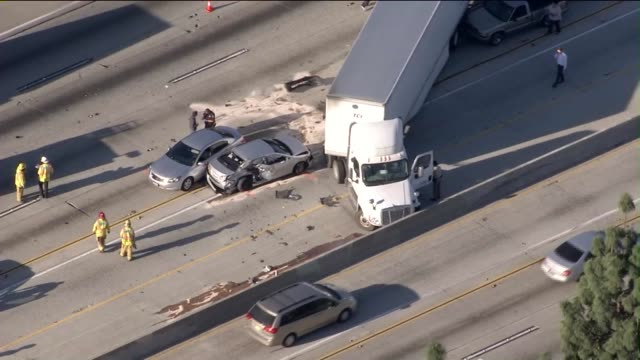 KTLA Aerial of a 12vehicle crash involving a jackknifed semitrailer on 10 freeway in Ontario on March 25 2015