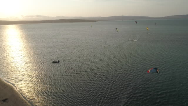 aerial of a bay with kitesurfer - kite sailing stock videos & royalty-free footage