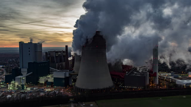aerial of a coal fired power station - coal fired power station stock videos and b-roll footage