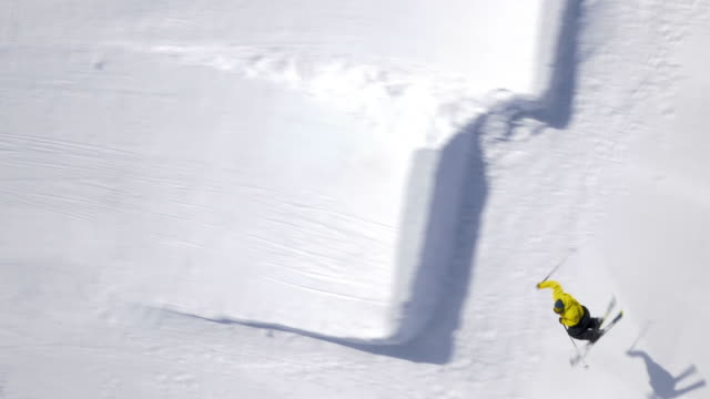 Aerial of a freestyle skier performing a jump with a rotation