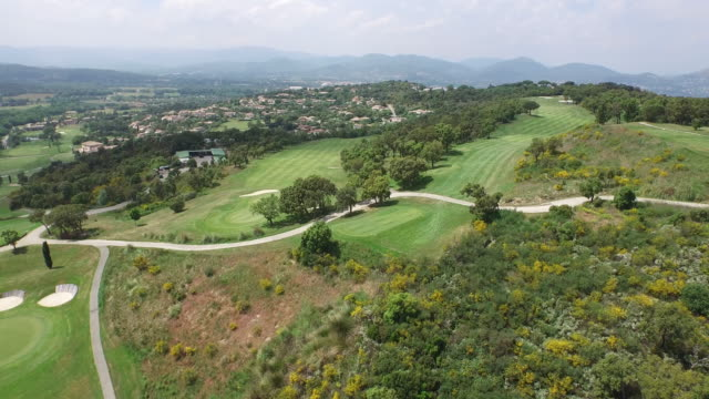 vidéos et rushes de aerial of a golf course and surrounding landscapes / saint-tropez, france - parcours de golf
