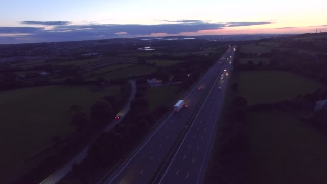 aerial of a highway at sunset - main road stock videos & royalty-free footage