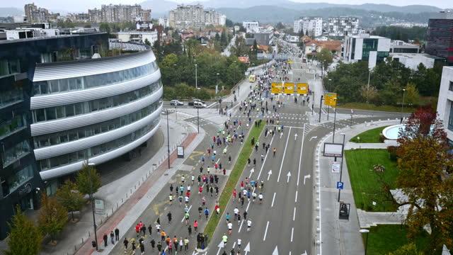 Aerial of a marathon going through main city street
