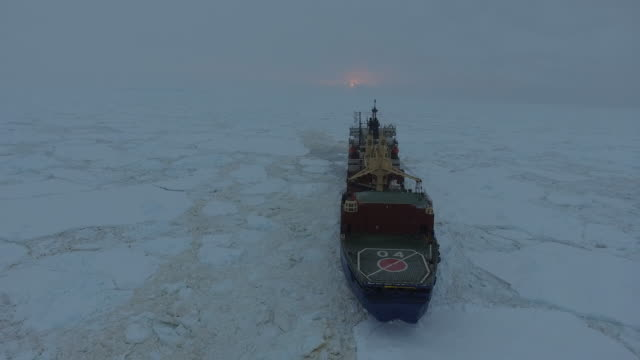 aerial of a russian ice class vessel breaking through pack ice enroute to the indian maitri station in antarctica - polar stock videos & royalty-free footage