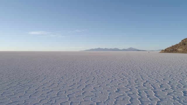 aerial of a salt lake with mountains - bolivia stock videos & royalty-free footage