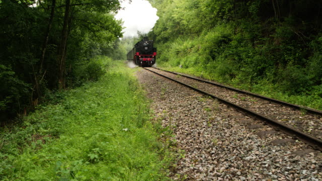 aerial of a steam train rolling on the tracks - steam train stock videos & royalty-free footage