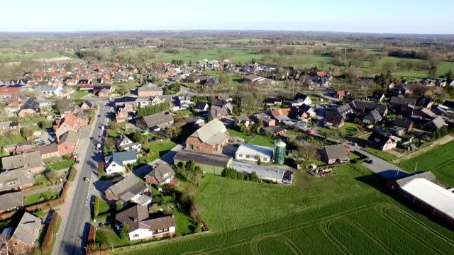 aerial of a village - schleswig holstein stock-videos und b-roll-filmmaterial