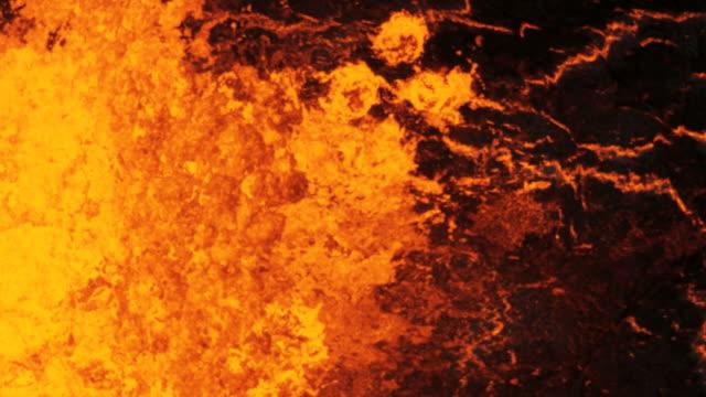 aerial of active volcano erupting red hot magma - 溶岩点の映像素材/bロール