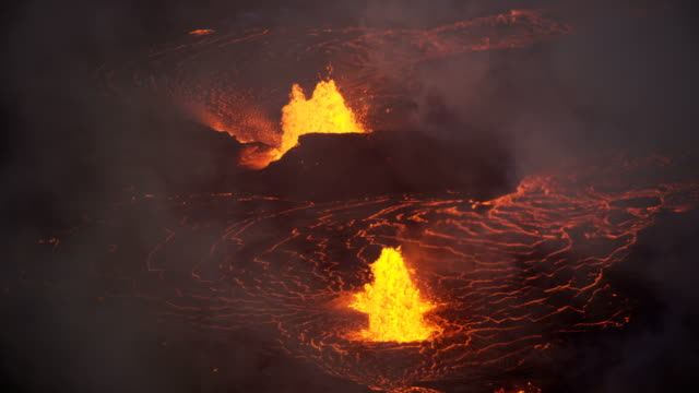 aerial of active volcano erupting red hot magma - tectonic stock videos & royalty-free footage