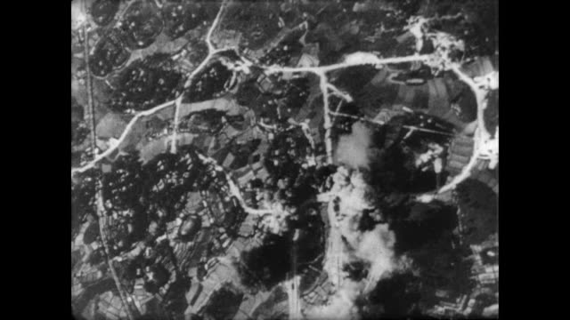 aerial of air strike along river in vietnam / explosions flash across countryside / closer view of bombs ripping through jungle / us paratroopers on... - vietnamkrieg stock-videos und b-roll-filmmaterial