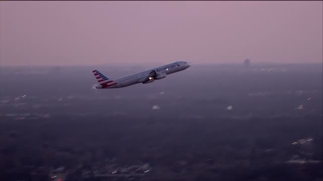 WGN Aerial of Airplane Taking off O'Hare Airport as Sun Sets in Chicago on Feb 22 2017