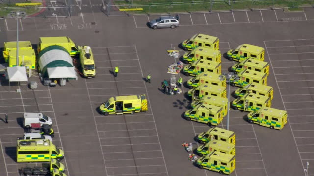 aerial of ambulances outside the nightingale hospital london the field hospital built in the excel centre to help nhs cope with demand during... - ambulance stock videos & royalty-free footage