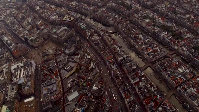 aerial of amsterdam center over dam square - paleis stock videos & royalty-free footage