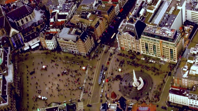 Aerial of Amsterdam center over looking down at Dam Square