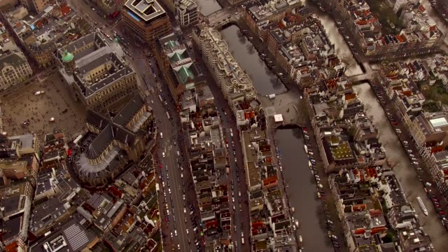 aerial of amsterdam center over looking down at dam square - paleis stock videos & royalty-free footage
