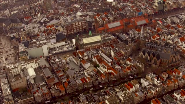 aerial of amsterdam center over looking tops of houses and buildings, canals - paleis stock videos & royalty-free footage