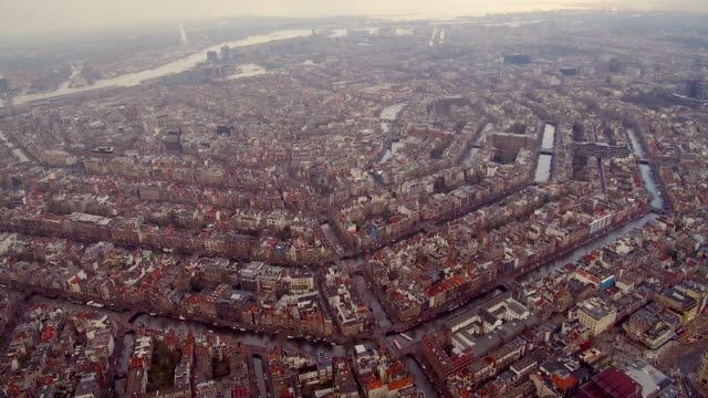 aerial of amsterdam city center with rooftops and canals - netherlands stock videos & royalty-free footage