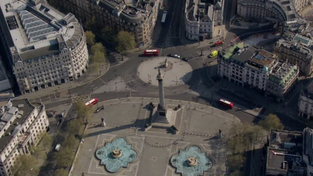 aerial of an empty trafalgar square in london during coronavirus lockdown - capital cities stock videos & royalty-free footage