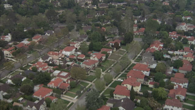 Aerial of an exclusive Pasadena residential neighborhood to a patio of the Huntington Hotel.