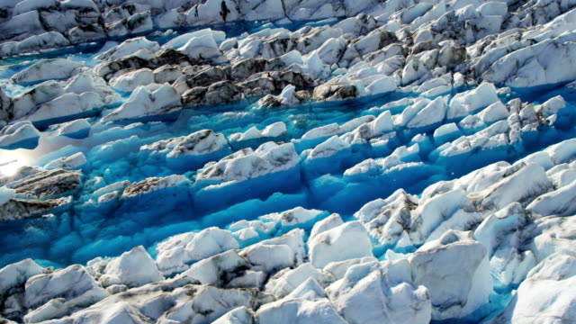 aerial of arctic glacier landscape alaska usa - ice crystal stock videos and b-roll footage