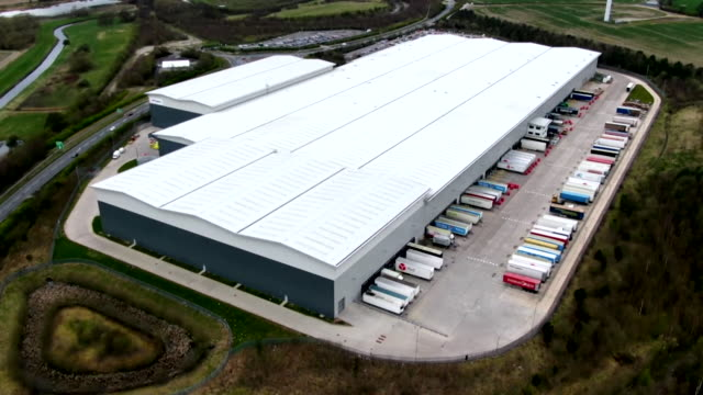 aerial of asos warehouse an online clothing business still in operation during the coronavirus crisis - online shopping stock videos & royalty-free footage