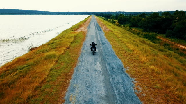 aerial of biker riding a bike on the road - following stock videos & royalty-free footage