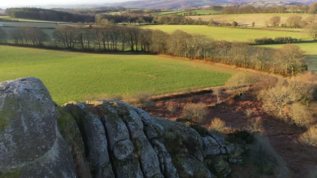 aerial of blackingstone rock granite tor and surrounding countryside, dartmoor, devon, england, united kingdom, europe - devon stock videos & royalty-free footage