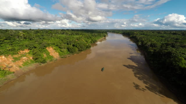 aerial of boat moving along amazon river - amazonas state brazil stock videos and b-roll footage