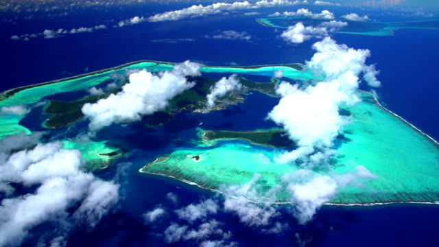 aerial of bora bora and tahaa vacation islands - isola di tahaa video stock e b–roll