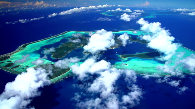 aerial of bora bora lagoon and tahaa island - isola di tahaa video stock e b–roll