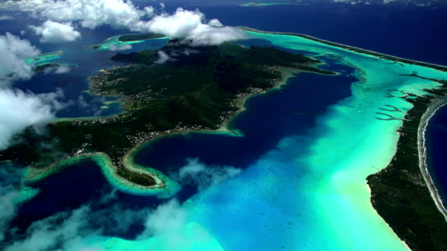 aerial of bora bora reef lagoon luxury resort - bora bora aerial stock videos and b-roll footage