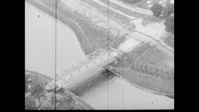 vidéos et rushes de / aerial of bridge across the rhine river / river cutting through downtown berlin / observation tower. berlin wall: rhine river and berlin... - 1962