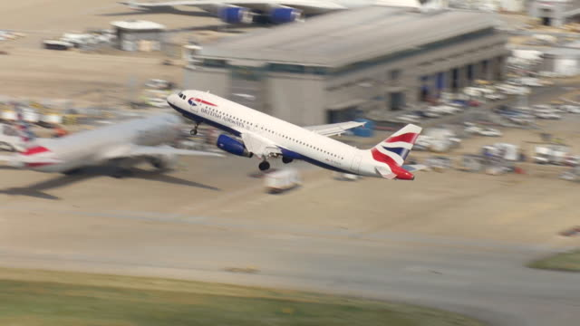 aerial of british airways aeroplane taking off from terminal 5 at heathrow airport - runway stock videos & royalty-free footage