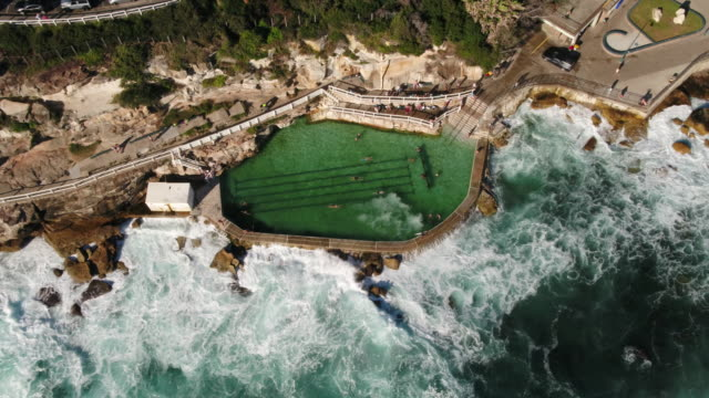 aerial of bronte pool, bronte beach, sydney, new south wales, australia, pacific - coastal feature stock videos & royalty-free footage