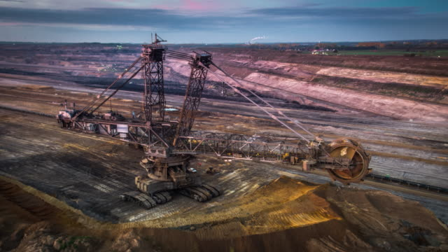 aerial of bucket wheel excavator in a surface coal mine - mining stock videos & royalty-free footage