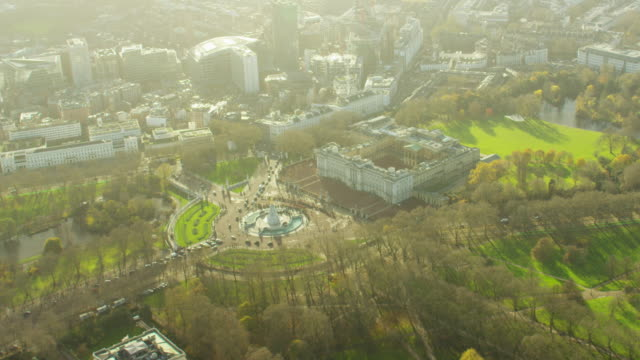aerial of buckingham palace and st james park london - queen royal person stock videos & royalty-free footage