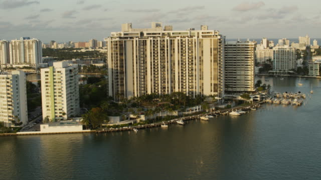 Aerial of buildings and hotels South Beach end of day Miami, FL